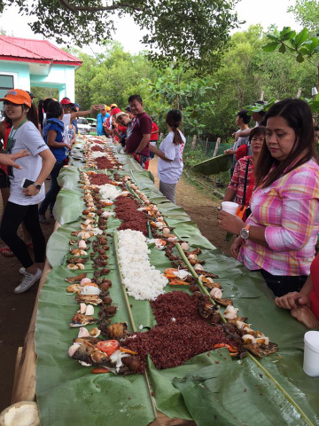 Boodle Fight Breakfast at the Bued mangrove with Alaminos City administrator, Dr. Gellado.