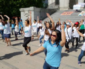 Mother's Day flash mob calls for permanent status for migrant caregivers
